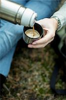 Cropped image of man pouring cup of coffee outdoors Stock Photo - Premium Royalty-Free, Artist: Mint Images, Code: 698-07635208
