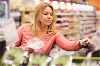 Woman buying groceries in supermarket Stock Photo - Premium Royalty-Freenull, Code: 698-07635215