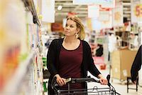 Mid adult woman buying groceries in supermarket Stock Photo - Premium Royalty-Freenull, Code: 698-07635227