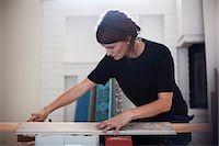 Female carpenter measuring wooden plank Stock Photo - Premium Royalty-Freenull, Code: 698-07635247