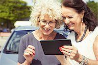 Happy senior women using digital tablet outdoors Stock Photo - Premium Royalty-Freenull, Code: 698-07635408