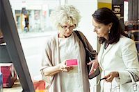 Senior women reading label on product in store Stock Photo - Premium Royalty-Freenull, Code: 698-07635429