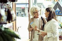 Senior women discussing over product in store Stock Photo - Premium Royalty-Freenull, Code: 698-07635431