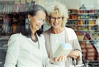 Senior women checking instructions on product in store Stock Photo - Premium Royalty-Freenull, Code: 698-07635432