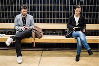 platform - Full length of people using technologies on bench at subway station Stock Photo - Premium Royalty-Freenull, Code: 698-07635487