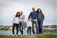 Full length portrait of homosexual families standing together at lakeshore Stock Photo - Premium Royalty-Freenull, Code: 698-07635519