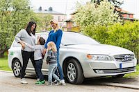 road trip - Playful homosexual family standing by car on street Stock Photo - Premium Royalty-Freenull, Code: 698-07635528