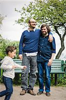 Affectionate gay couple with son playing in park Stock Photo - Premium Royalty-Freenull, Code: 698-07635537