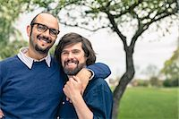 Portrait of affectionate gay couple at park Stock Photo - Premium Royalty-Freenull, Code: 698-07635542