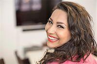 Portrait of happy businesswoman in creative office Stock Photo - Premium Royalty-Freenull, Code: 698-07635676