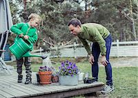 popping (bursting not corks or pimples) - Father and son gardening together in yard Stock Photo - Premium Royalty-Freenull, Code: 698-07635690