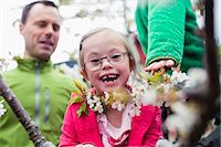Portrait of happy handicapped girl with father and brother in yard Stock Photo - Premium Royalty-Freenull, Code: 698-07635697