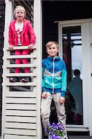 Portrait of brother and sister at porch Stock Photo - Premium Royalty-Freenull, Code: 698-07635698