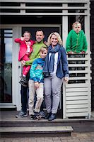 Portrait of happy family standing at porch Stock Photo - Premium Royalty-Freenull, Code: 698-07635699