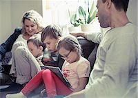 Family of five sitting on sofa at home Stock Photo - Premium Royalty-Freenull, Code: 698-07635730