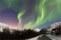 sky stars - Northern Lights (Aurora Borealis) above Road and Snow Covered Mountains in Arctic, Troms, Norway Stock Photo - Premium Rights-Managednull, Code: 700-07636918