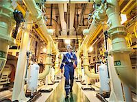 supply - Engineer walking amongst pipes of nuclear power station Stock Photo - Premium Royalty-Freenull, Code: 649-07647799