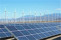 solar panel usa - Photovoltaic solar panels and wind turbines, San Gorgonio Pass Wind Farm, Palm Springs, California, USA. This solar installation has a 2.3 MW capacity Stock Photo - Premium Royalty-Freenull, Code: 649-07648209