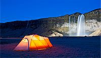 Illuminated tent and Seljalandsfoss waterfall at night, South Iceland Stock Photo - Premium Royalty-Freenull, Code: 649-07648255