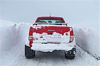 Mature woman driving red pick up truck on snow walled road, Fljotsheidi, North Iceland Stock Photo - Premium Royalty-Freenull, Code: 649-07648267