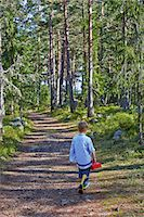 Young boy wandering along forest path Stock Photo - Premium Royalty-Freenull, Code: 649-07648409