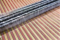 Close up of striped textile on weaving machine in woollen mill Stock Photo - Premium Royalty-Freenull, Code: 649-07648501