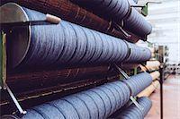 Rolls of wool in woollen mill Stock Photo - Premium Royalty-Freenull, Code: 649-07648504