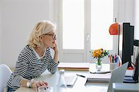 ebusiness - Mature woman at home using computer Stock Photo - Premium Royalty-Freenull, Code: 649-07648523