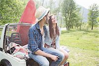 Friends sitting on back of off road vehicle Stock Photo - Premium Royalty-Freenull, Code: 649-07648541