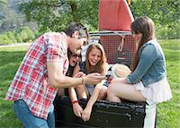 Friends sitting on back of off road vehicle Stock Photo - Premium Royalty-Freenull, Code: 649-07648543