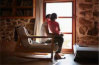 Mid adult man and daughter looking out of window Stock Photo - Premium Royalty-Freenull, Code: 649-07648612