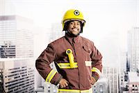Portrait of confident fireman in urban window Stock Photo - Premium Royalty-Freenull, Code: 6113-07648750