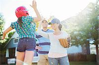 preteen family - Family playing baseball Stock Photo - Premium Royalty-Freenull, Code: 6113-07648763