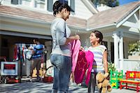 Mother and daughter shopping for clothes at yard sale Stock Photo - Premium Royalty-Freenull, Code: 6113-07648850