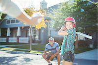 preteen family - Family playing baseball in street Stock Photo - Premium Royalty-Freenull, Code: 6113-07648858