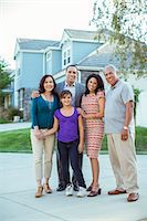 preteen girl boyfriends - Portrait of multi-generation family in driveway Stock Photo - Premium Royalty-Freenull, Code: 6113-07648869