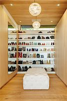 Modern walk-in closet with shoes on shelves Stock Photo - Premium Royalty-Freenull, Code: 6113-07648950