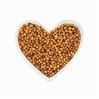 Coriander seeds in a heart-shaped dish. Stock Photo - Premium Royalty-Freenull, Code: 679-07649550