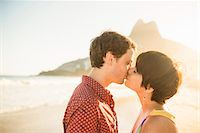 Young couple kissing at sunset, Ipanema Beach, Rio, Brazil Stock Photo - Premium Royalty-Freenull, Code: 614-07652208
