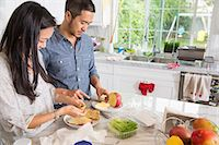 Mid adult couple preparing sandwich at kitchen counter Stock Photo - Premium Royalty-Freenull, Code: 614-07652358