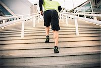 Cropped shot of mature male runner training on steps Stock Photo - Premium Royalty-Freenull, Code: 614-07652362