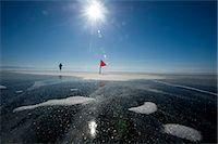 Runner in the 10th Baikal Ice Marathon, run on the frozen surface of the world's largest fresh water lake on 1st March 2014, Siberia, Irkutsk Oblast, Russia, Eurasia Stock Photo - Premium Rights-Managed, Artist: Robert Harding Images, Code: 841-07653162