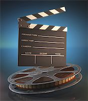 Clapperboard and roll of film in the retro concept cinema. Stock Photo - Royalty-Freenull, Code: 400-07658167