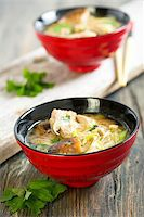 Miso soup with duck breast in red cups. Stock Photo - Royalty-Freenull, Code: 400-07659030