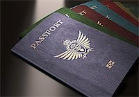 Colorful passports on a dark reflective table. Stock Photo - Royalty-Freenull, Code: 400-07668471