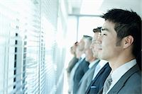 Business people looking out window Stock Photo - Premium Royalty-Freenull, Code: 635-07670743