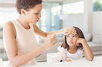 Mother taking daughter's temperature Stock Photo - Premium Royalty-Freenull, Code: 635-07670815