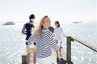 Friends on pier Stock Photo - Premium Royalty-Freenull, Code: 635-07670941