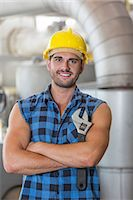 Portrait of confident industrial worker standing arms crossed Stock Photo - Premium Royalty-Freenull, Code: 693-07672629