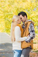Couple kissing in park during autumn Stock Photo - Premium Royalty-Freenull, Code: 693-07672895
